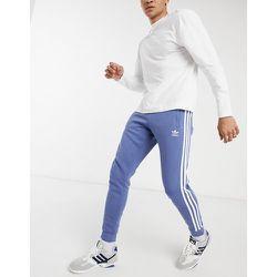 Adicolor - Jogger à trois bandes - adidas Originals - Modalova