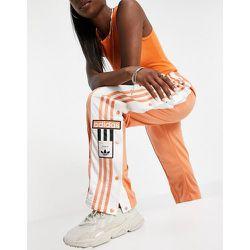 Adicolor - Pantalon de jogging avec logo sur le côté - Cuivre brumeux - adidas Originals - Modalova
