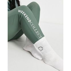 Chaussettes longueur mollet côtelées à logo brodé - ASOS Weekend Collective - Modalova