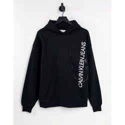 Hoodie avec logo monogramme vertical - Calvin Klein Jeans - Modalova