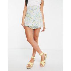 Mini-jupe portefeuille d'ensemble coupe trapèze à imprimé floral rétro - Motel - Modalova