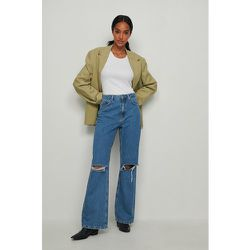 Biologique jean déchiré coupe ample - Blue - NA-KD Trend - Modalova